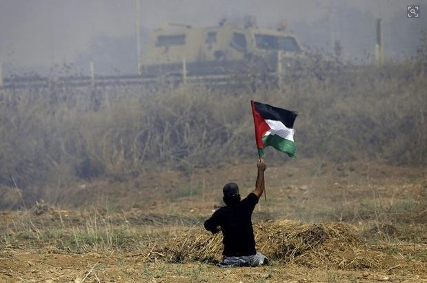Ibrahim raising flag