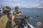Israeli navy officers with guns