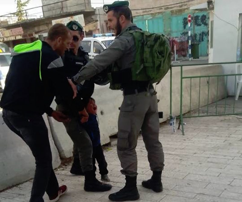 3yr old held by IOF