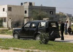 Zerbombtes Fahrzeug der PM Kolonne in Gaza nach Anschlag