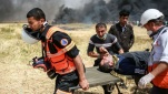 Wounded man carried away in Gaza