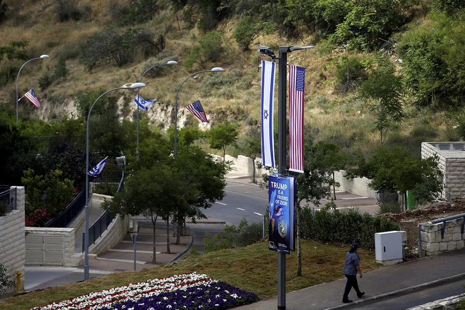 Trump poster Israel US flags flowerbed in front of US Embassy