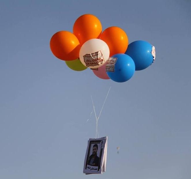 Ballone mit Bildern Getöteter - Sami Abu Tabak:qudns