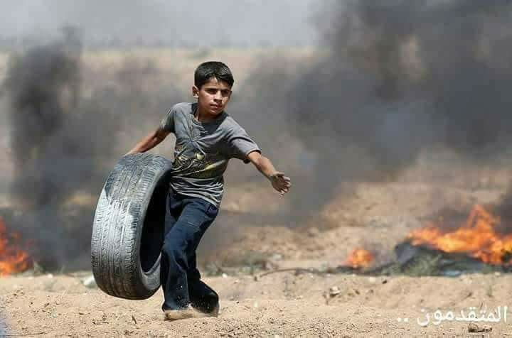 Haytham al-Jamal with tyre