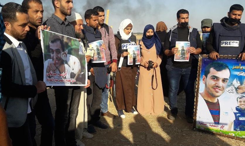 Journalists stage protest after killing of Yaser Murtaja