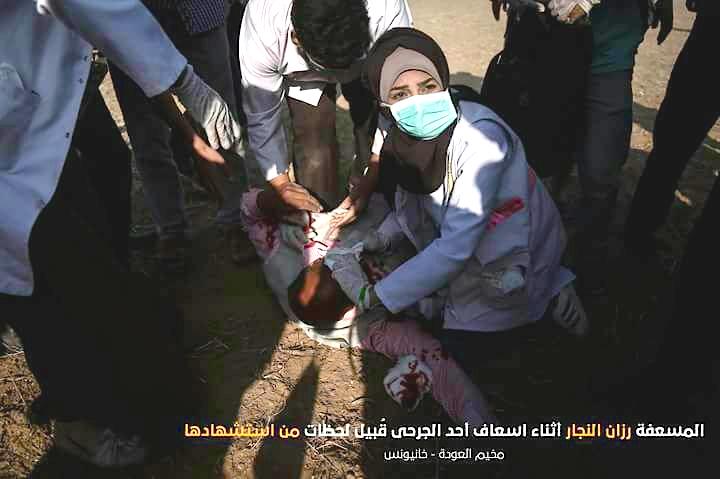 Razan assists elderly man